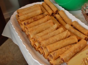 "The Filipinio version of the egg roll or spring roll is called ""Lumpia"" and was the most popular dish at the reception.  All food and drink was donated by those attending.  This one vanished quickly."