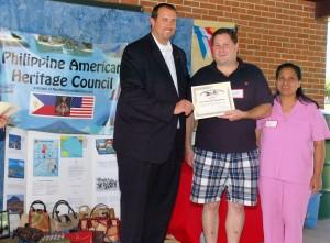 PA State Rep. Seth Grove presents 2013 picnic Sponsor certificate to Scott & Josefina Montgomery.