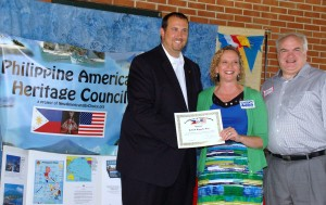 Rep. Seth Grove presents Pam Gay & husband Jeff Picnic Sponsor Certificate.  Pam spoke as a candidate for York County Coroner.  She won.