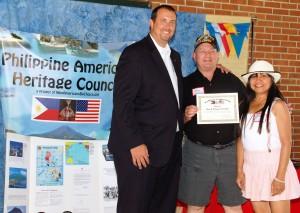 PA State Rep. Seth Grove (L) awards Picnic Sponsor Certificate to Jon & Jan Sienick.