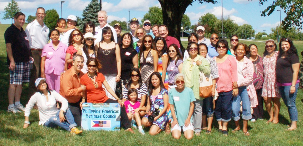 Many (but not all) of the attendees of the 2013, Second annual picnic of the Philippine American Heritage Council pose with keynote speaker, Congressman Scott Perry.