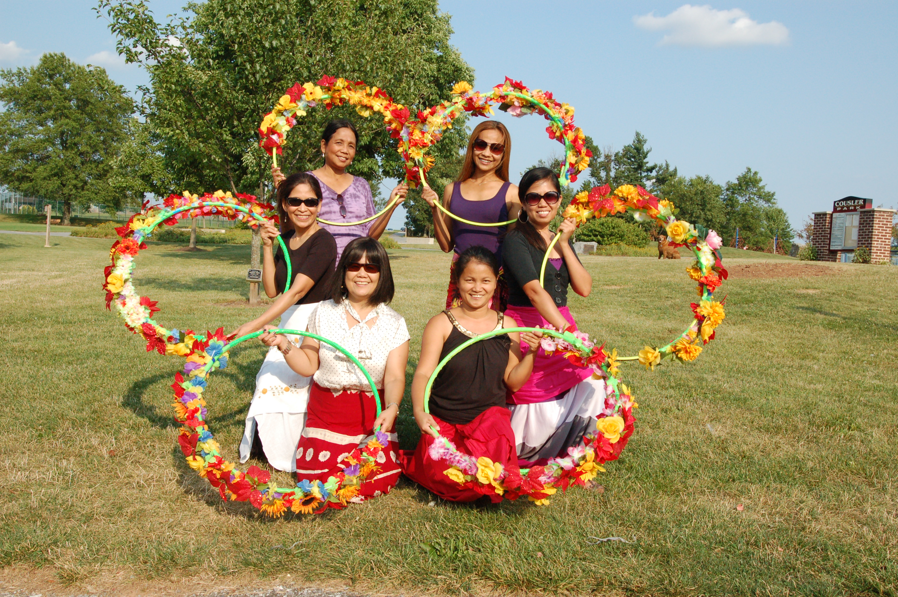 "The Dance Troop of the Philippine American Heritage Council at a practice session in an area park, preparing for their debut performance at the 3rd annual picnic on Aug. 3.  Clockwise, starting lower left corner: Priscilla Bachman, Emy Delgaudio, Milagros Thomas, Mary Anne Nielsen, Emee Hemme, Jhoann McCarthy.  Their next and last practice will be ""full dress rehearsal"" with their new costumes."