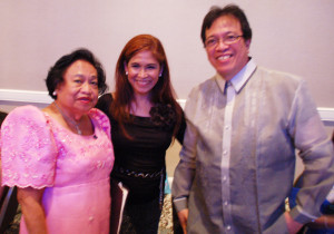 "International Day Chairman Gwen DeVera tells Ed Garcia, President of Barangay ""N Friends, and Emy Delgaudio, President of Philippine American Heritage Council, about her plans for the October 10 ""International Day"" at the annual Banquet of the National Federation of Filipino American Associations conference on August 15, 2015."