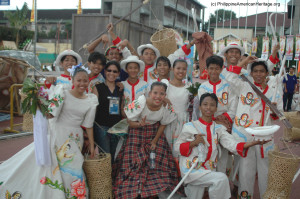 Philippine American Heritage Council Chairman Emy Delgaudio with some of the performers who also participate in the festive and massive parade of Sinulog in Cebu City, Philippines, 2005.