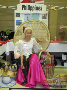 Evelyn Miller, a founding member of Philippine American Heritage Council, shown here at the first cultural display and food booth wearing native Philippine costume in 2012, RIP 2/17/16
